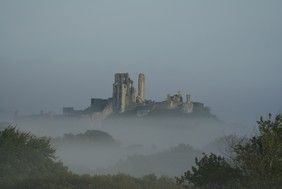 The enigmatic Corfe Castle, with much history beneath its surface, set in the pass or corfe in Anglo-Saxon of the Purbeck Hills of Dorset, excellent location for story telling and raiding the keep as if Vikings - picture: purbeckfootprints.com